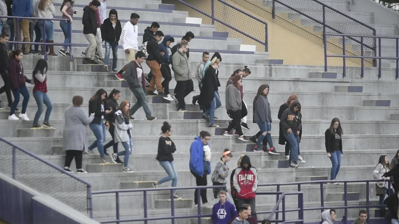 Students at Sevier County High School walk out onto the football field at 10 a.m. in tribute to the 17 victims of the Marjory Stoneman Douglas High School shooting in Parkland, Florida, in Sevierville Wednesday March 14, 2018