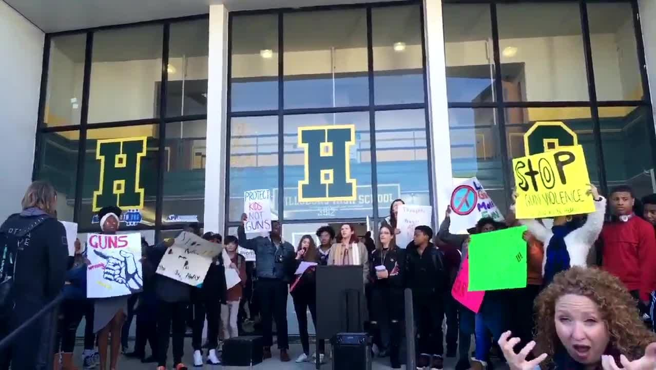 Hillsboro High School students participate in a walkout during National School Walkout Day.