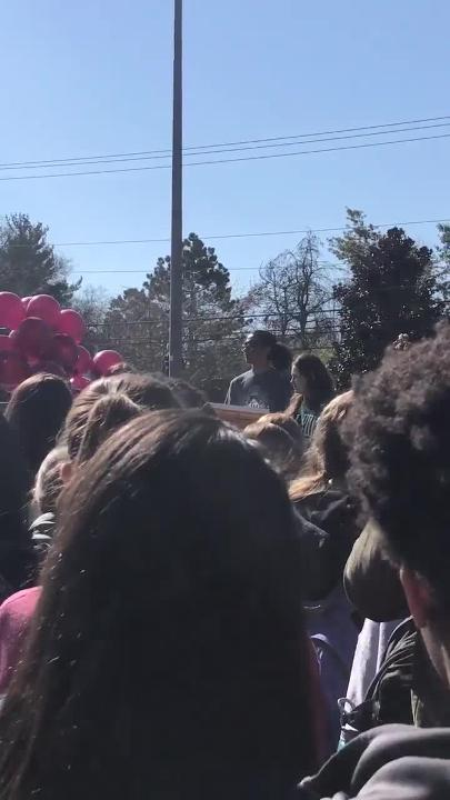 Brentwood High School students release balloons in memory of the Parkland, Fla. school shooting victims during their walkout on Wednesday.
