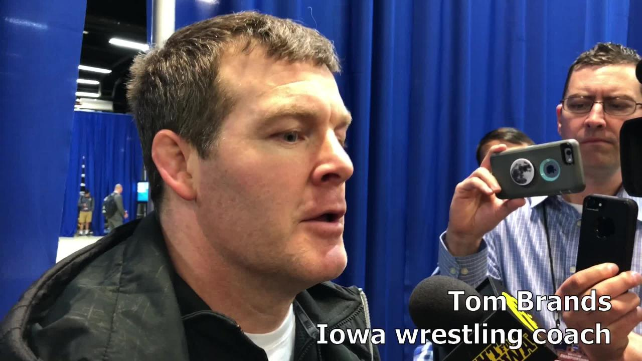 Iowa wrestling coach Tom Brands reacts after the Hawkeyes went 9-1 with six bonus-point wins in Session I of the NCAA Championships.