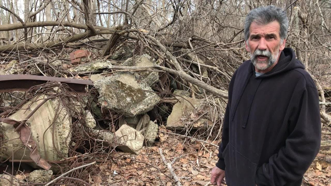 Longtime Pompton Lakes resident Bob Kislowski lives near a wooded area littered with debris including industrial pumps, motors, electric panels and concrete with rebar sticking out.