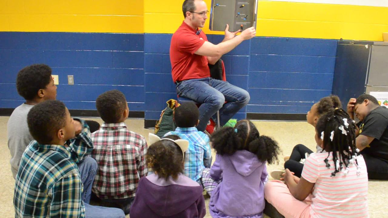 """Professor Watermelon"" reads aloud to students at IPS School 43."