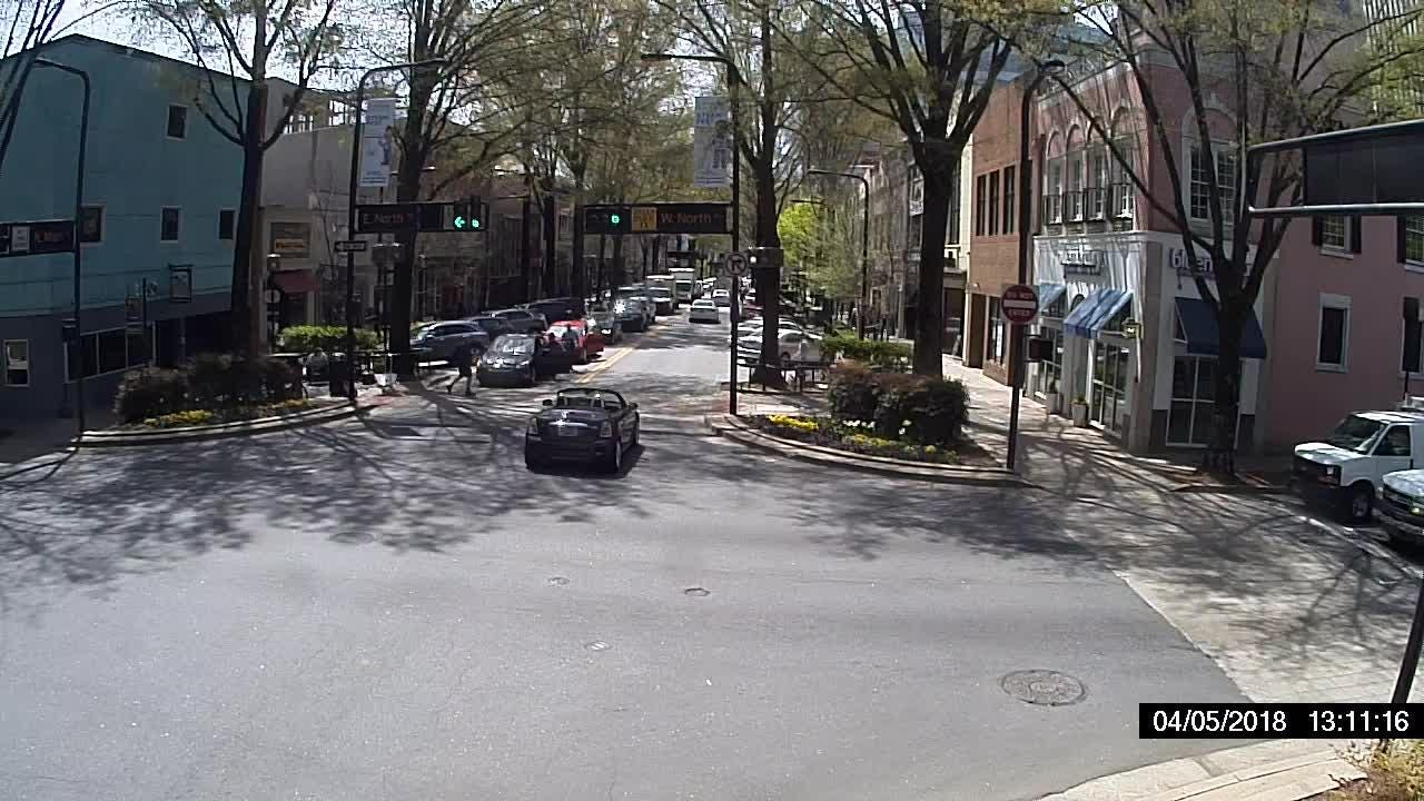 A surveillance video from the Greenville Police Department shows the scene of an attempted carjacking in downtown Greenville in broad daylight last week.