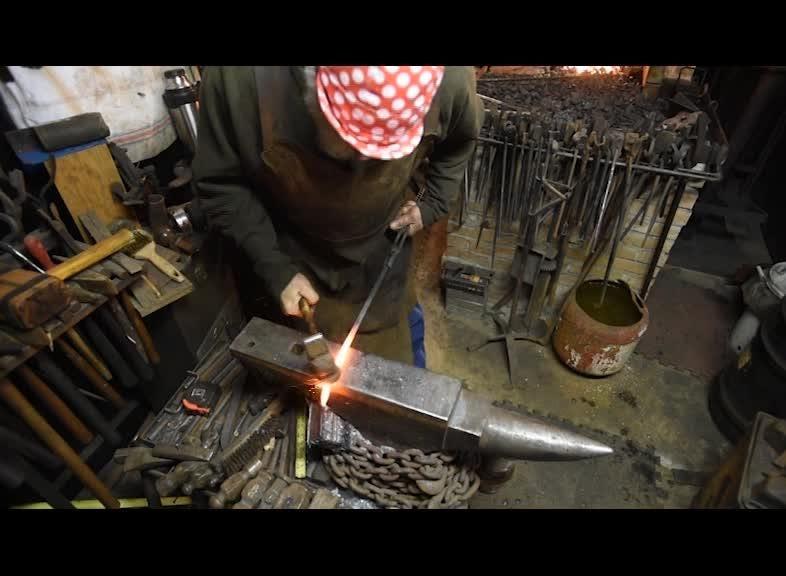 John Abrams makes metal into art via his forge.