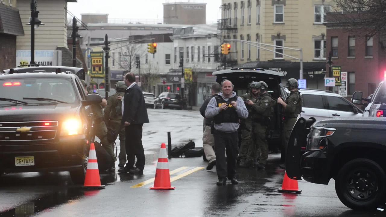 Bergen County Regional SWAT Team gather in the downtown area for a person barricaded in a building