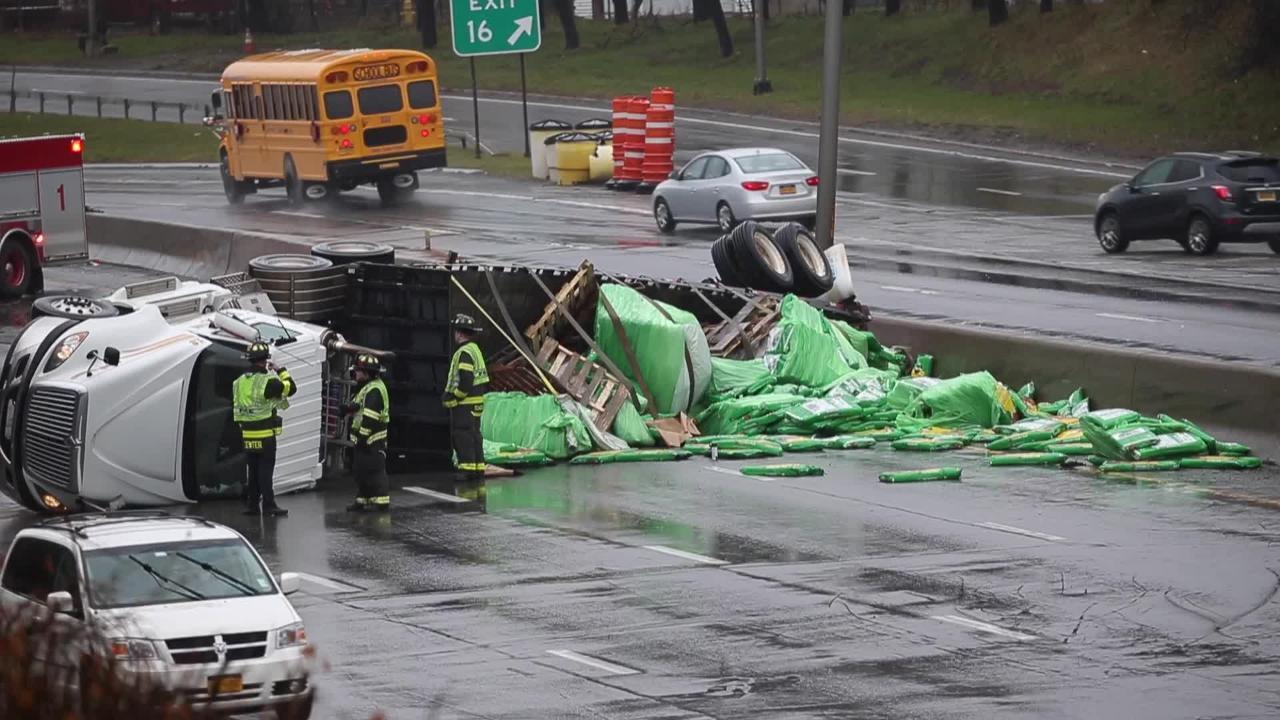 Truck tips, blocks I-490 lanes