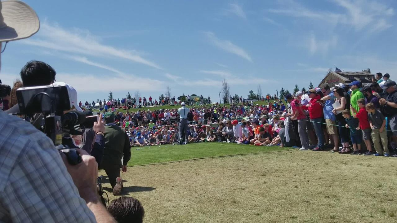 Tiger Woods entertains the crowd with practice shots and stories at free golf clinic in Hollister.