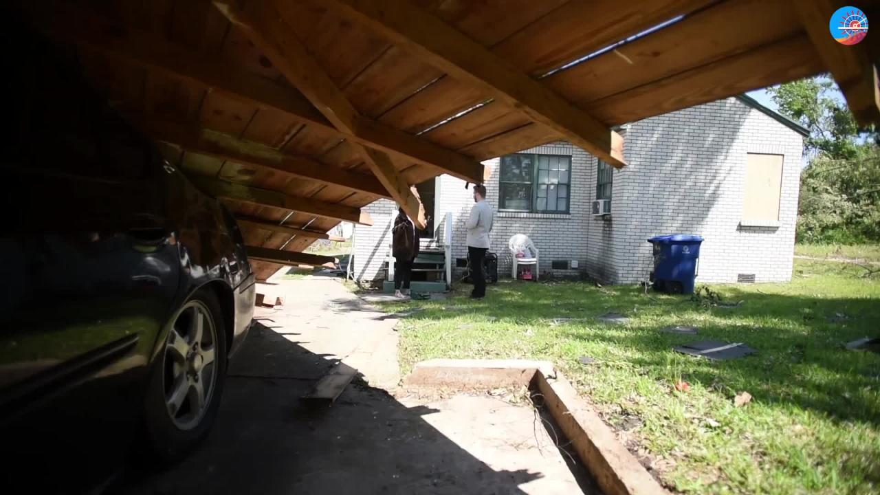 Patricia Pennywell had to crawl out of her car window after the carport fell on top of it during the storm in the Queensborough neighborhood in Shreveport.