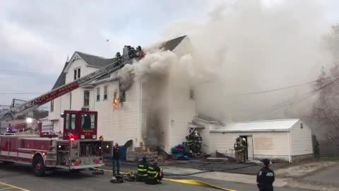 Firefighters battle blaze at King of Delancey deli on Main Avenue in Passaic on April 18, 2018.