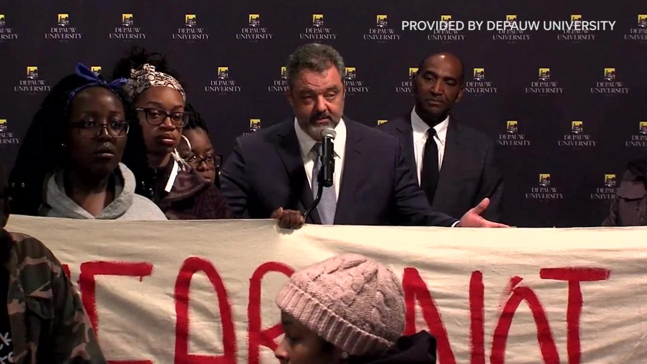 "About two dozen students from the university's Association of African-American Students interrupted the news conference led by President Mark McCoy while carrying signs and chanting, ""We are not safe."""