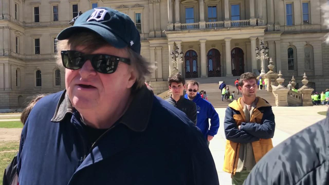 Filmmaker Michael Moore speaks as Michigan Education Associationmembers deliver petition signatures opposing laws allowing guns in schools to the Capitol.