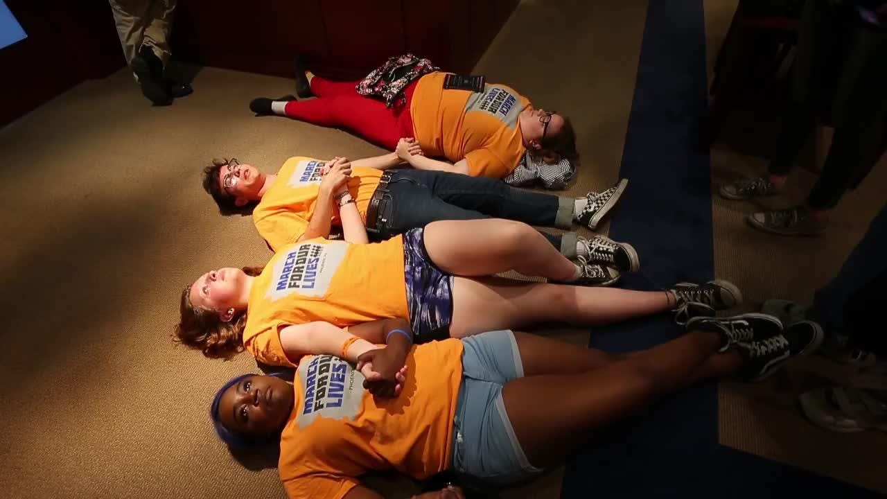 """March for Our Lives activist Jordan Harb, a junior at Mountain View High, and other high school students hold a """"die-in"""" in Gov. Ducey's office."""