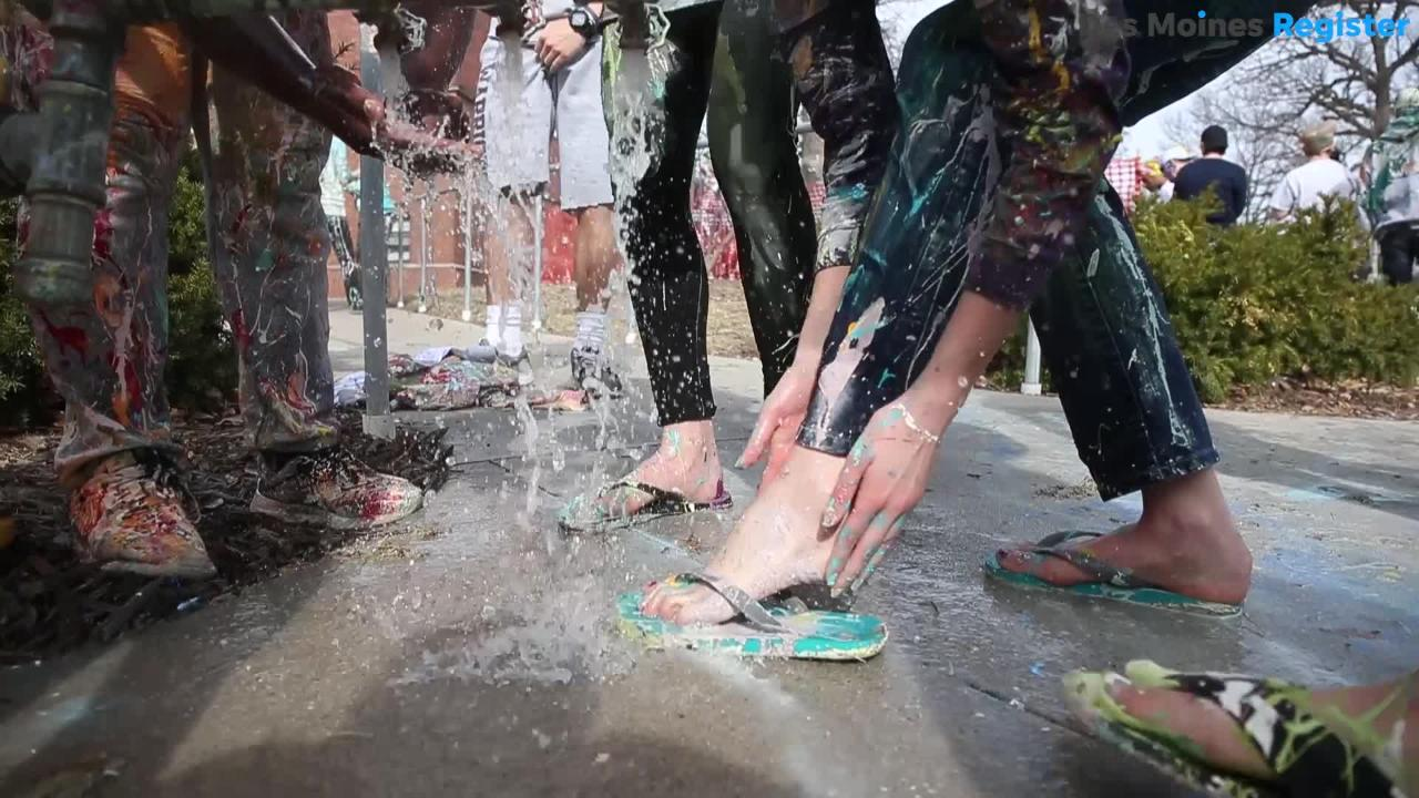 Drake University students take part in annual street painting ahead of the 2018 Drake Relays.