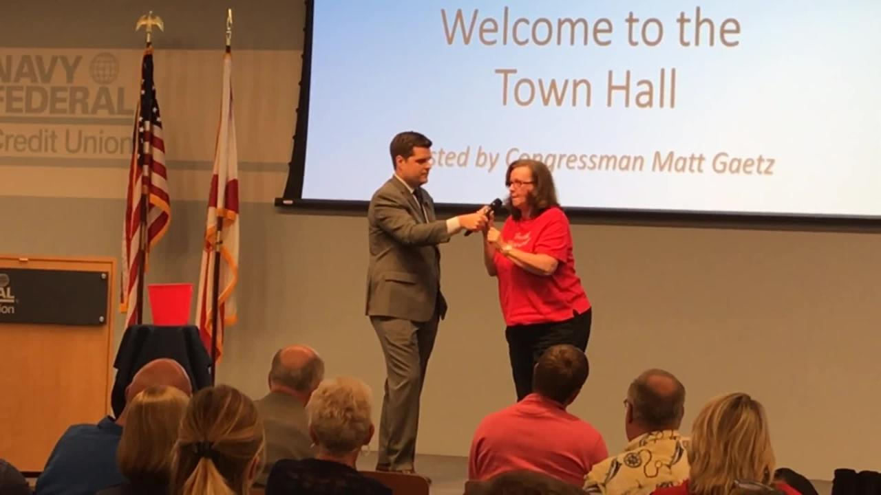 A woman upset over Rep. Matt Gaetz's views on the Second Amendment confronts him and refuses to leave the stage on April 20, 2018.