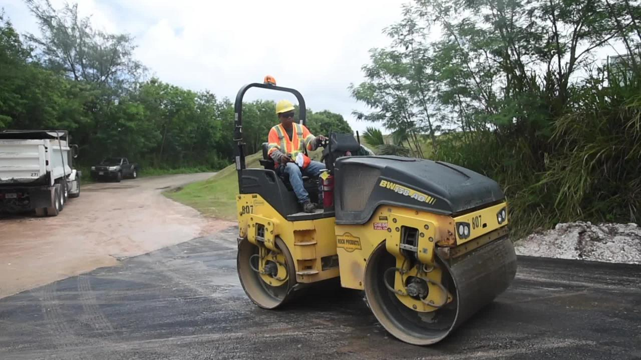 Haw'n Rock Products roller man Pedro Lagman works on the newly paved Santate Lane in Piti on April 23, 2018.