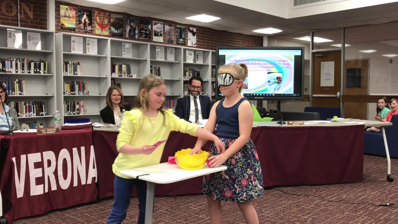 Forest Avenue students show Verona Board of Education members on April 24, 2018, what they did during Read Across America week.