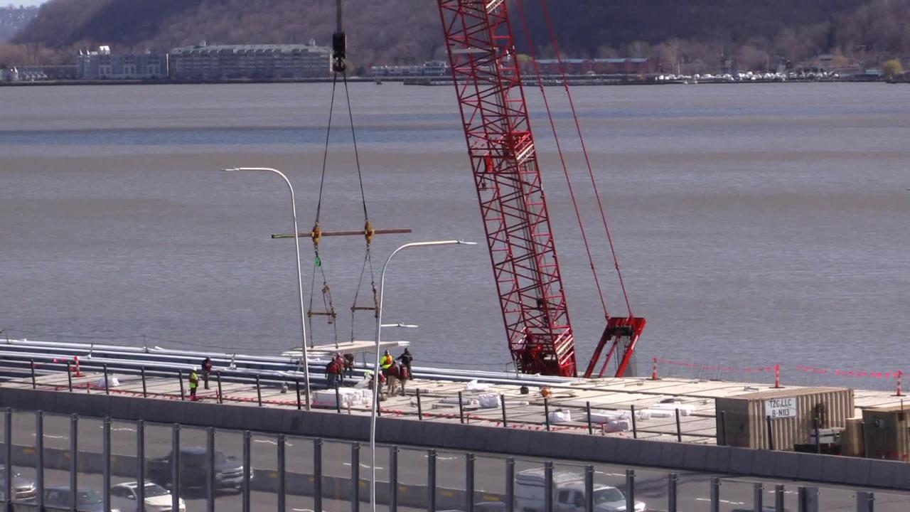 Time lapse video of workers installing road deck panels near the Rockland landing of the Gov. Mario M. Cuomo Bridge. (Peter Carr/The Journal News)
