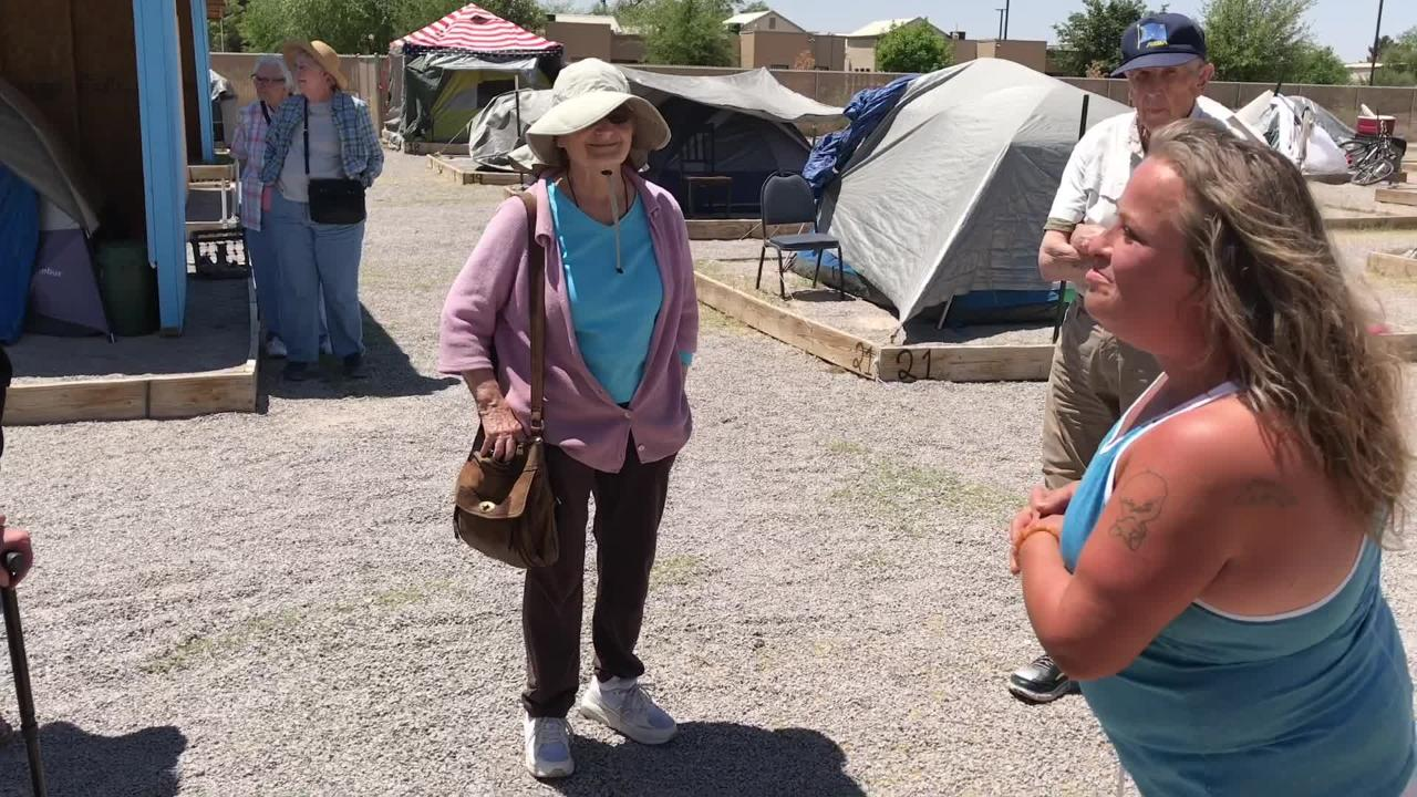 Mesilla Valley Community of Hope tent city resident Cindy Inman takes guests on a tour of the facilities.
