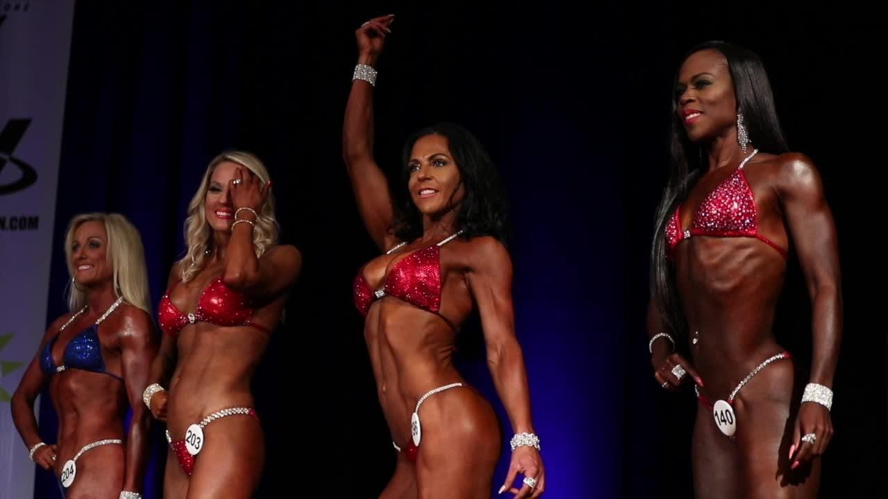 Fitness buffs and bodybuilders flex on the 2018 KDF Derby Championship stage at the Galt House.