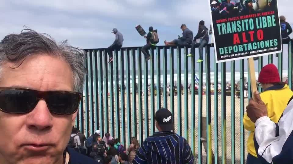 Supporters of migrant caravan gather at border fence in Tijuana, Mexico