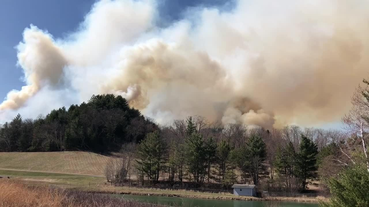 Smoke and flames at Bruce Mound Ski Hill can be seen Sunday, April 29, 2018.