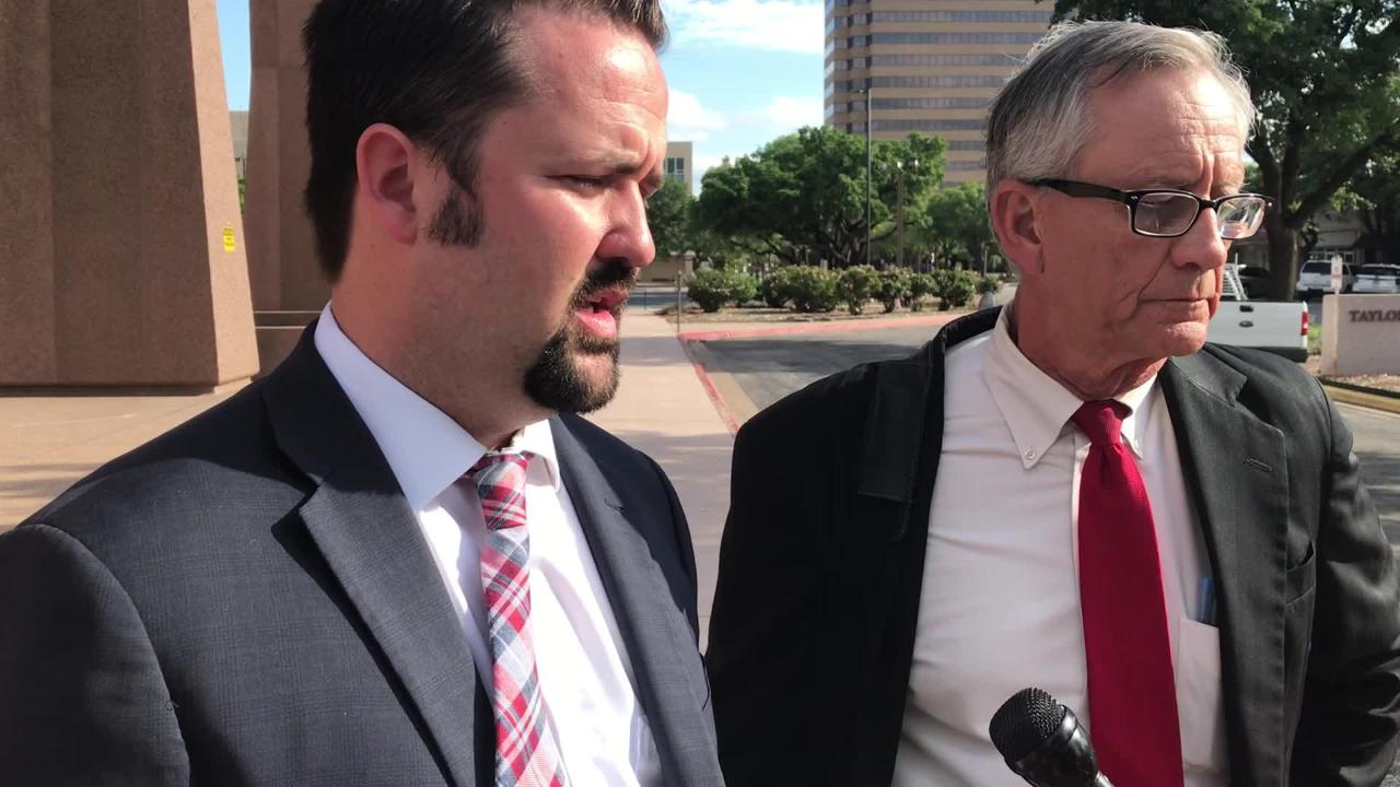 Jacob Blizzard, left, and Ken Leggett talk with the media about the Damian Cate's murder trial, which they won after 65 minutes of jury deliberations