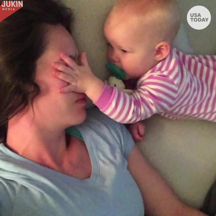This mom is desperately trying to get some sleep but that is no match for her baby as she pokes and prods her to keep her awake.