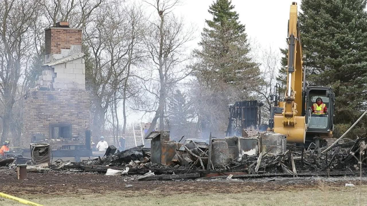 The remains of two people were found inside a burned home.