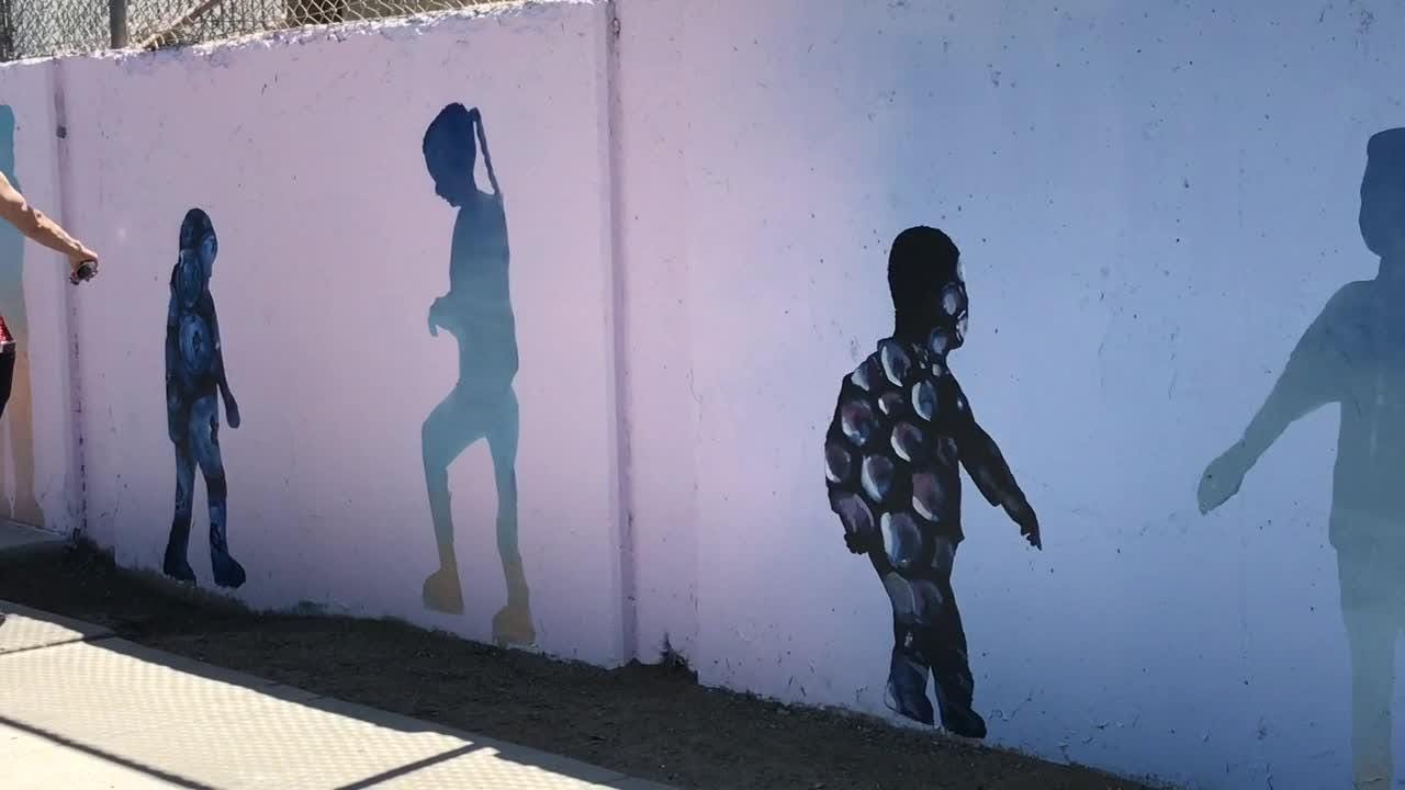 Community leaders celebrated the completion of a new mural along East 10th Street in Reno. The mural, painted by artist Erik Burke, promotes healthy lifestyles for Reno families.