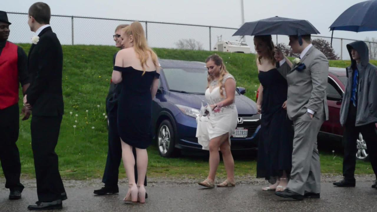 Students and guests of the Lancaster High School prom arrived at a rainy Fairfield County Fairgrounds for the school's annual prom.
