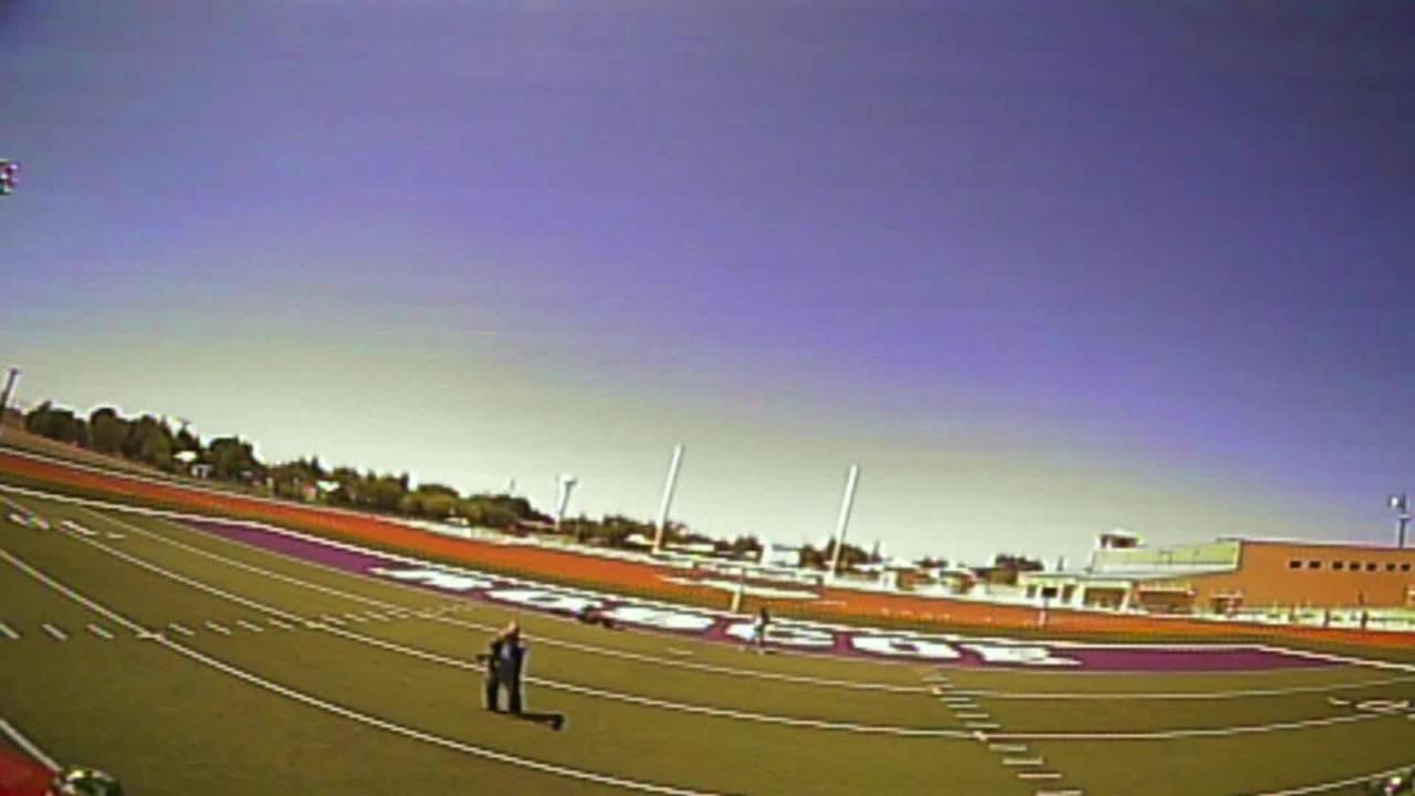 ATEMS High School Senior flies his custom racing drone over Plowboy Field at Roscoe Collegiate High School.