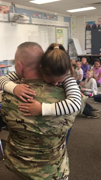 Ava, 9, was surprised in her Granville Elementary classroom, when her father turned out to be the day's surprise reader.
