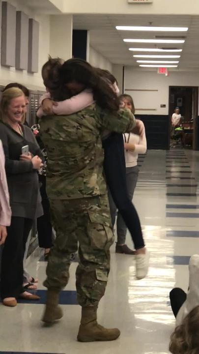 Two Granville girls recently tearfully reunited with their father, Army Col. Trent D. Upton, who surprised them in school after spending nearly a year overseas.