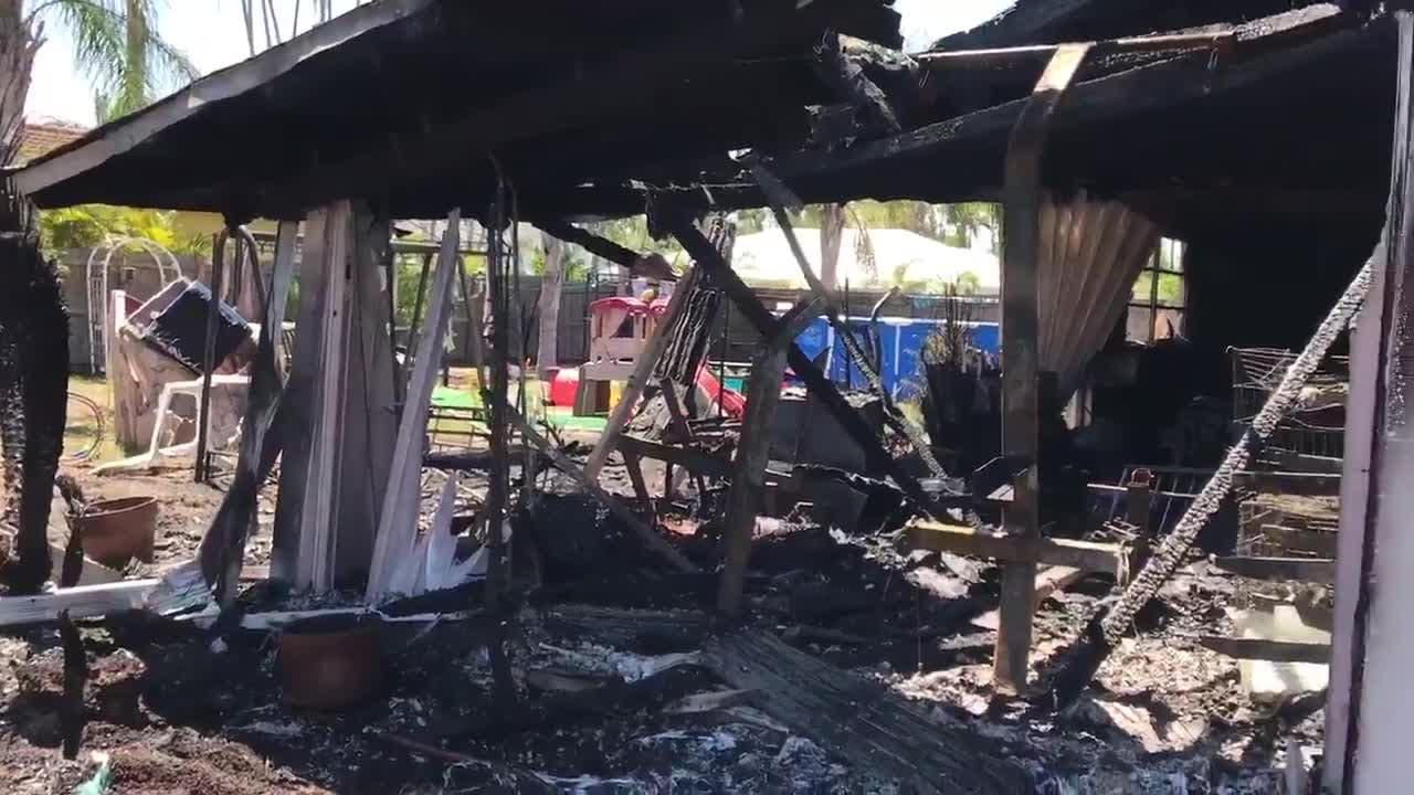 Bonita Springs firefighters battle house fire on Wednesday, May 9, 2018. The home had extensive damage in the back.