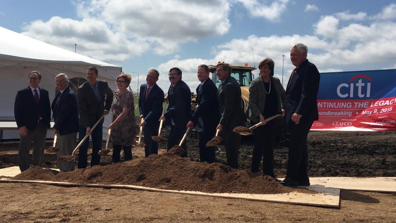 Dignitaries including Citi leaders and state and local officials, break ground at the new Citi campus site in southwest Sioux Falls on Wednesday.