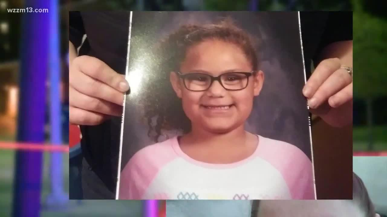 Nevaeh Alston, who died after being struck by a car in Grand Rapids, was holding fresh fruit and her mother's hand just before the deadly accident.