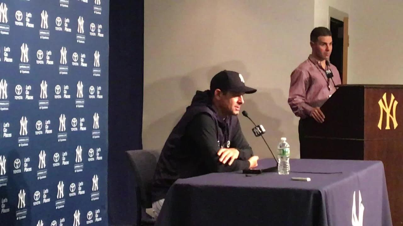 Yankees manager Aaron Boone talks his three outfielders prior to the game on Wednesday, May 9.