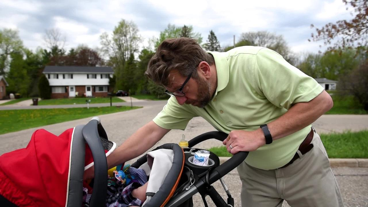 Jesse Green, with Families for Reopening Wardcliff School, walks his son around the school's grounds and talks about his desire to see it reopened.