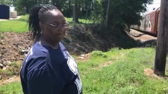 Melissa McCullough, Ernestine Dixon's cousin, speaks about losing her loved one on the train tracks and the wait for a promised pedestrian bridge.