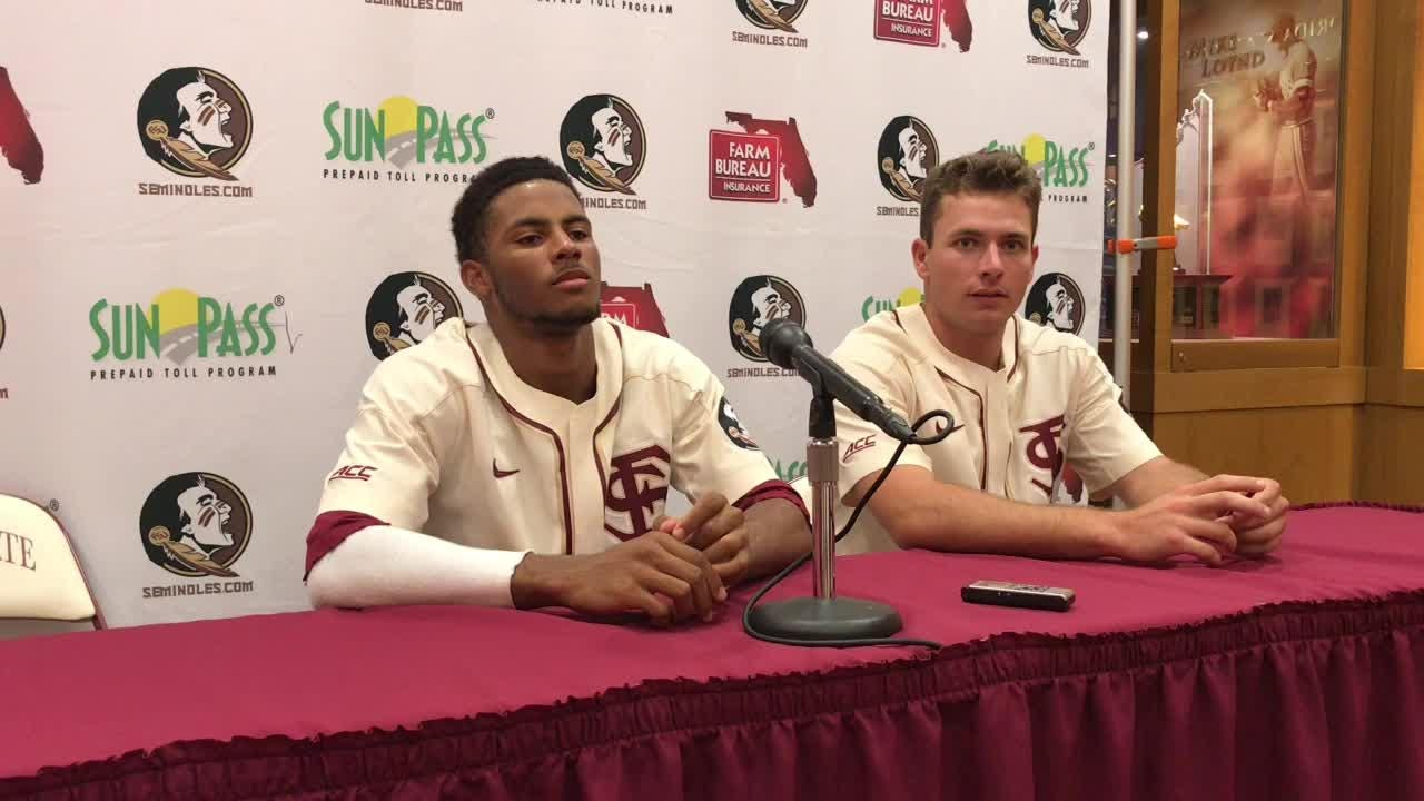FSU centerfielder J.C. Flowers and pitcher Drew Parrish talk after the Noles 12-2 win over Mount St. Mary's.