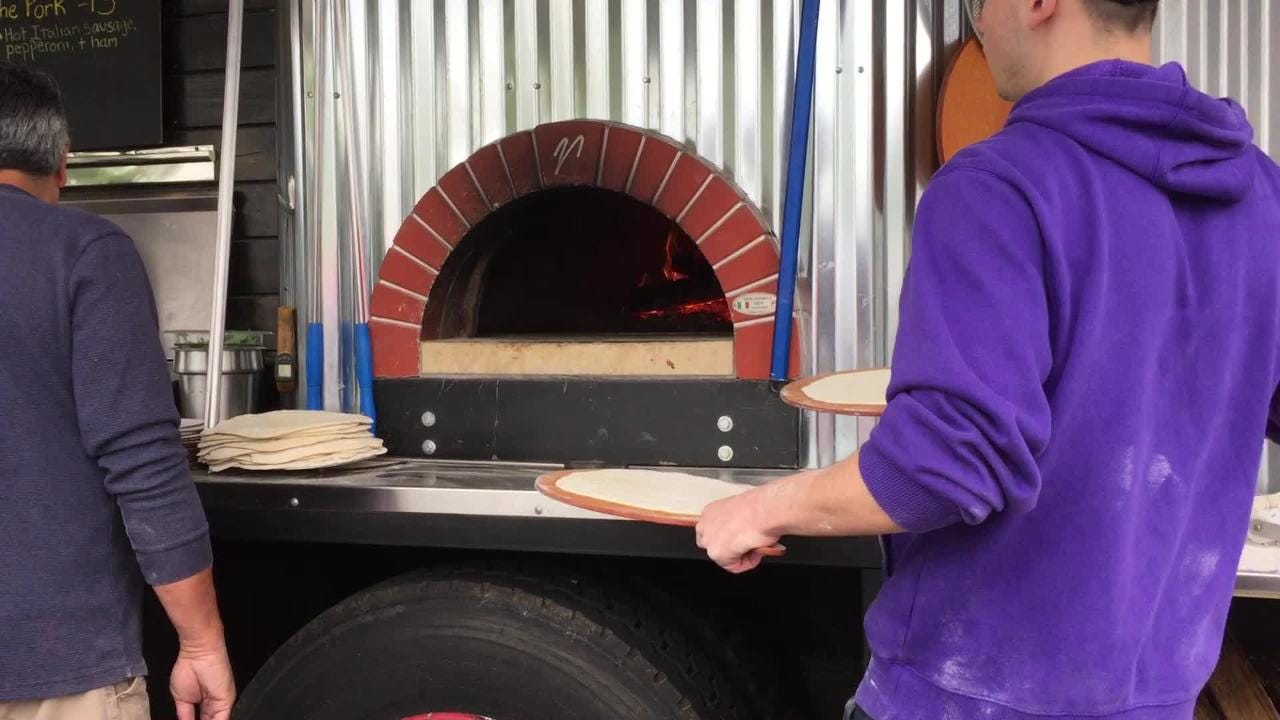 Watch Nooner's Wood Fired Pizza cook at the TruckTrek food truck festival in Palmyra