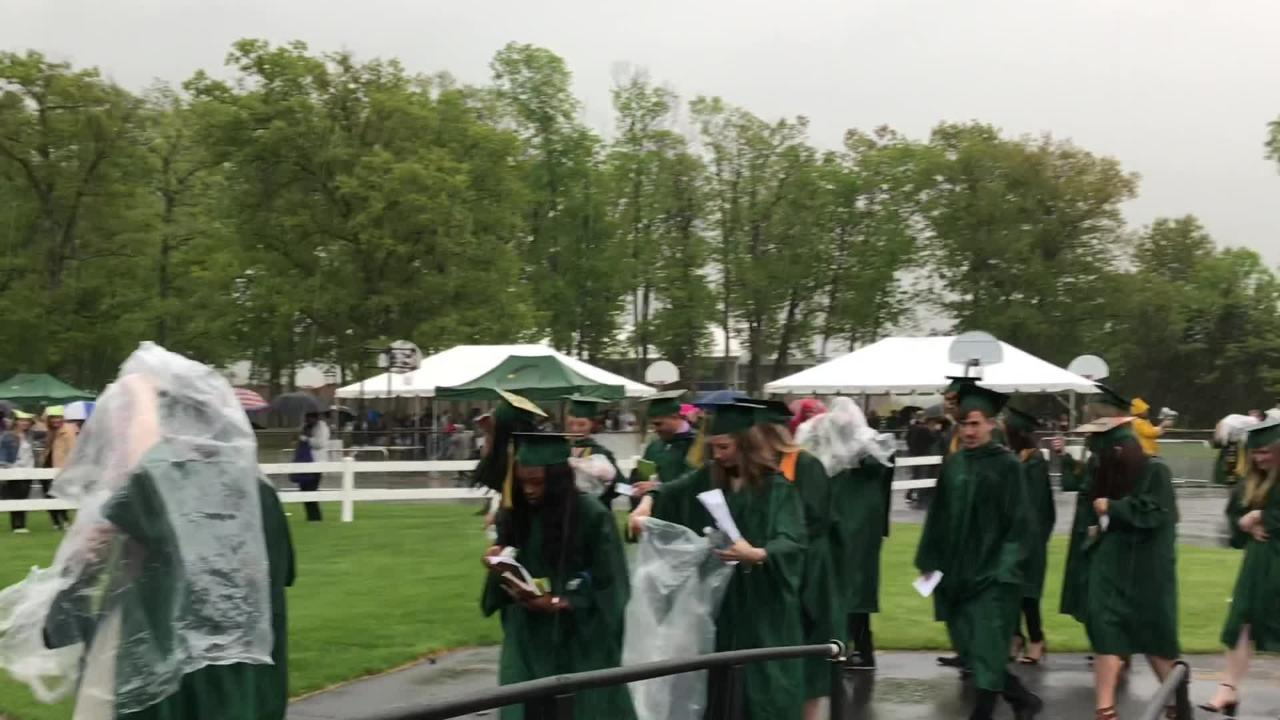 Hundreds og graduates walked at the 2018 Raritan Valley Community College graduation despite the rain.