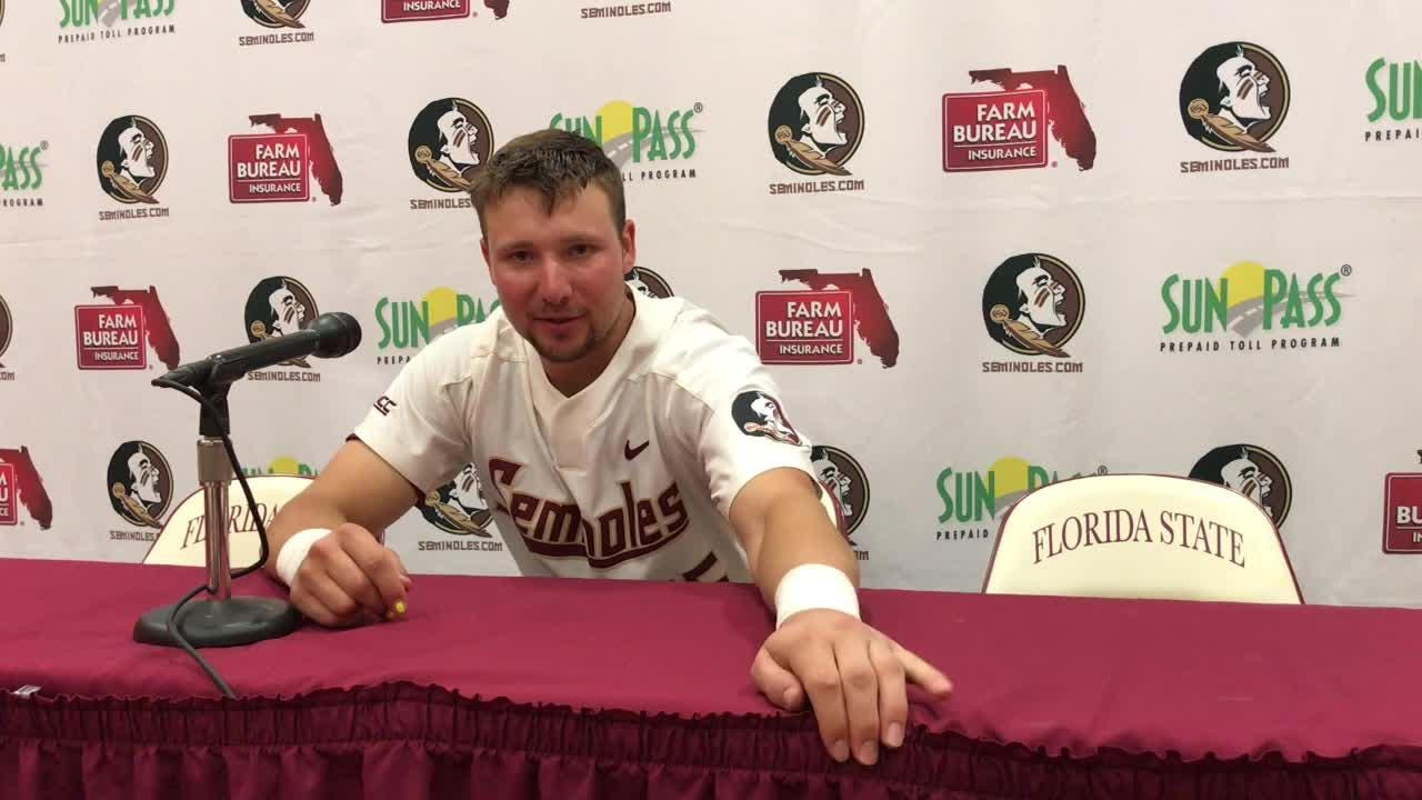 FSU pitcher Andrew Karp and catcher Cal Raleigh talk after FSU's doubleheader sweep of Mount St. Mary's.