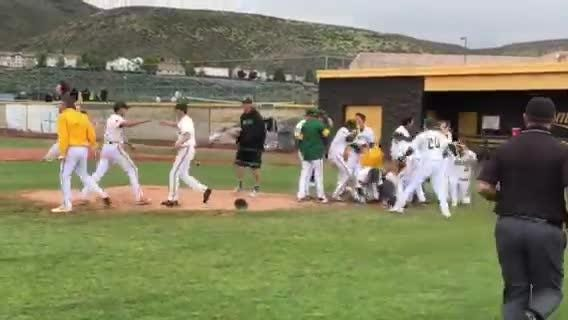 The Miners celebrate after beating Reno for the Northern 4A Region baseball title on Saturday.