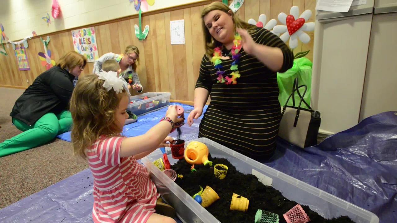 Children, dirt mix at Redeemer Lutheran Preschool to make a Mother's Day