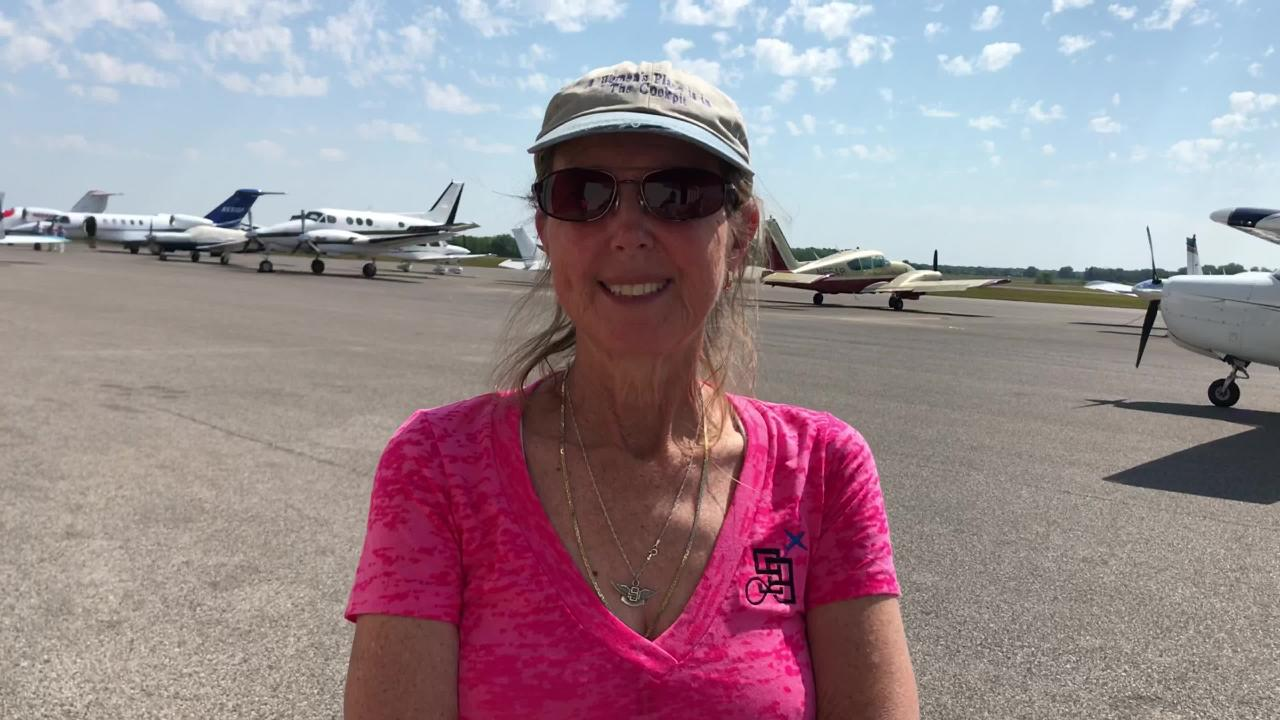 Female pilots inspire young girls by giving them their first airplane flight.