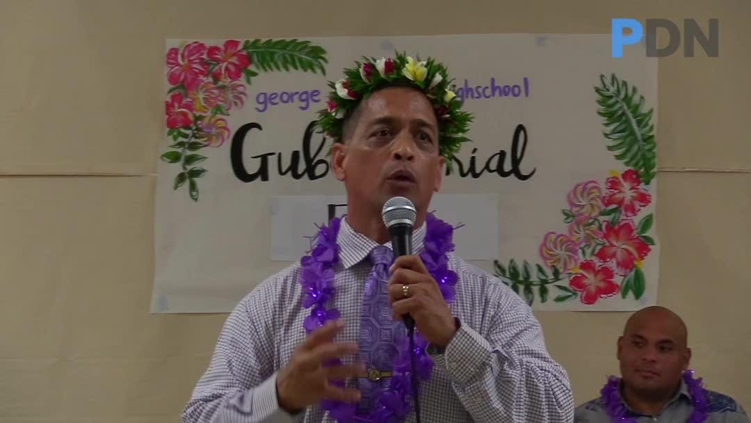 Gubernatorial candidate Sen. Frank Aguon Jr. responds to a student's question on the rising cost of living during a student forum and GWHS.