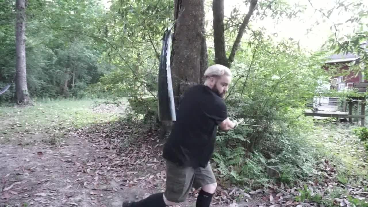 A local bladesmith and knife maker shows off one of his repurposed blades on a pair of 15-foot, 30-pound King Mackerels.