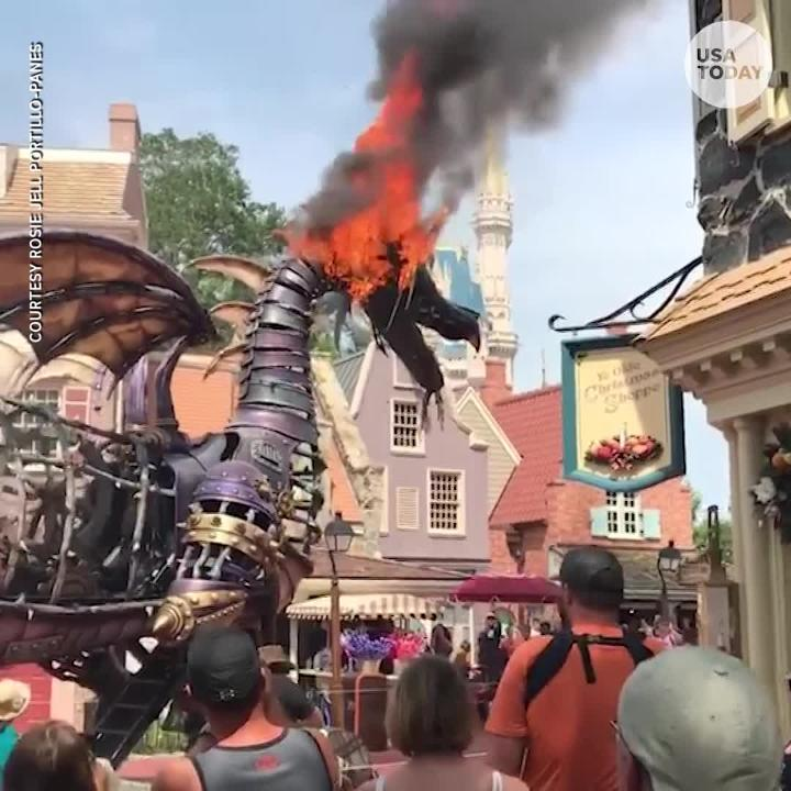 A Maleficent dragon float unexpectedly caught on fire during a parade at Disney World's Magic Kingdom in Orlando.