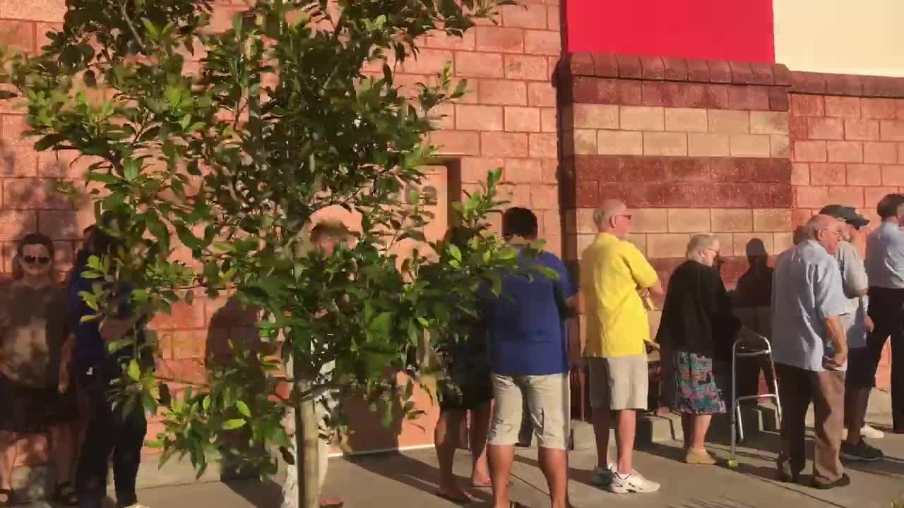 People wait outside Winn-Dixie in Naples. More than eight months since Hurricane Irma, the storm-damaged supermarket reopened with a new look.